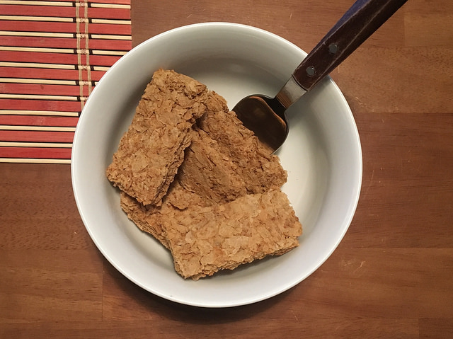 weet-bix wheat biscuits in bowl with no milk and spoon