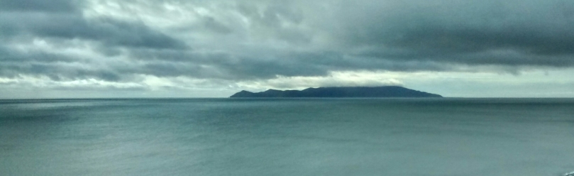 Kapiti Island on a cloudy day over the Tasman Sea