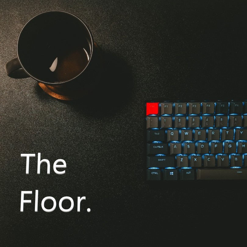 coffee cup and backlit computer keyboard with title 'The Floor'